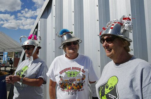 "From left, sisters Kathy Richey, Gerry Garcia and Sandy Haney wait in line for the gift shop at the Storm Area 51 Basecamp event Friday, Sept. 20, 2019, in Hiko, Nev. The event was inspired by the ""Storm Area 51"" internet hoax."