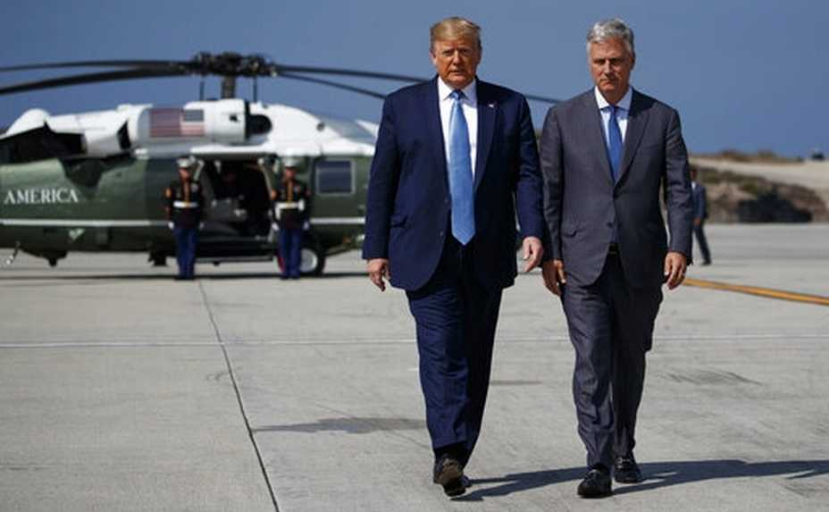 President Donald Trump and new National security adviser Robert O'Brien walk to talk with reporters before boarding Air Force One at Los Angeles International Airport, Wednesday, Sept. 18, 2019, in Los Angeles. (AP Photo/Evan Vucci)