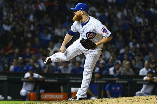 Chicago Cubs relief pitcher Craig Kimberly delivers during the tenth inning of a baseball game against the St. Louis Cardinals, Thursday, Sept. 19, 2019, in Chicago.