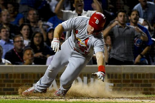 St. Louis Cardinals' Paul Goldschmidt scores during the sixth inning of a baseball game against the Chicago Cubs, Thursday, Sept. 19, 2019, in Chicago.