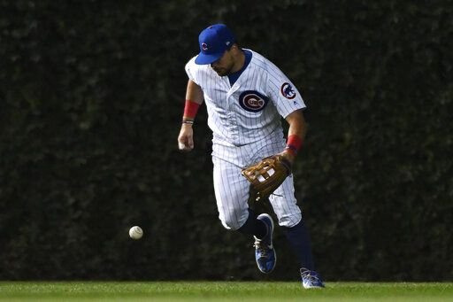 Chicago Cubs left fielder Kyle Schwarber makes a fielding error on an RBI-single hit by St. Louis Cardinals' Yadier Molina during the sixth inning of a baseball game Thursday, Sept. 19, 2019, in Chicago.