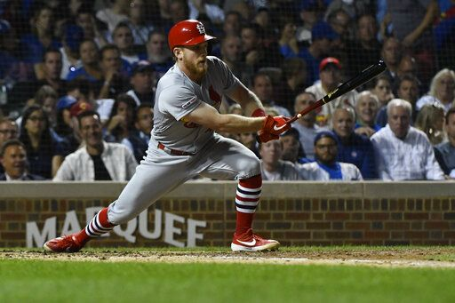 St. Louis Cardinals' Harrison Bader hits an RBI-single during the fifth inning of a baseball game against the Chicago Cubs, Thursday, Sept. 19, 2019, in Chicago.