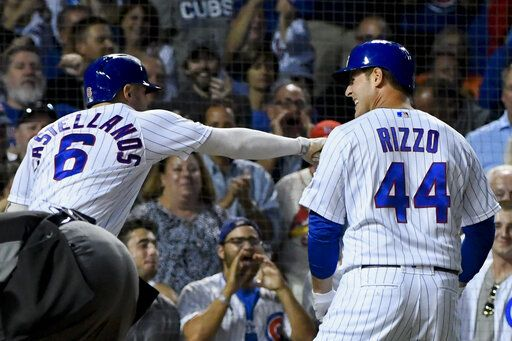 Chicago Cubs' Anthony Rizzo (44) celebrates with Nicholas Castellanos, left, after Rizzo hit a home run against the St. Louis Cardinals during the third inning of a baseball game Thursday, Sept. 19, 2019, in Chicago.