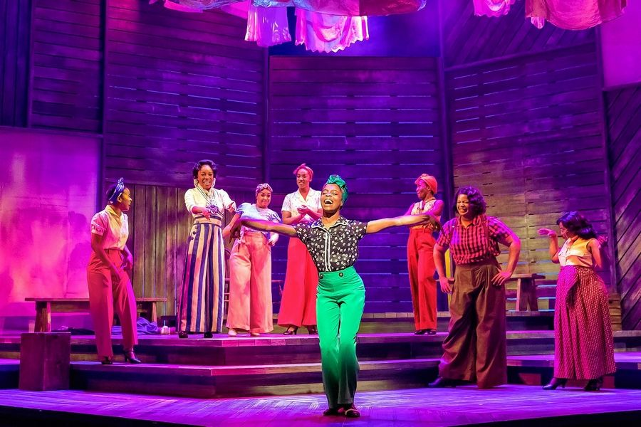 "Celie (Eben K. Logan), center, sings about her successful business in the ensemble number ""Miss Celie's Pants"" in ""The Color Purple"" at Drury Lane Theatre in Oakbrook Terrace."