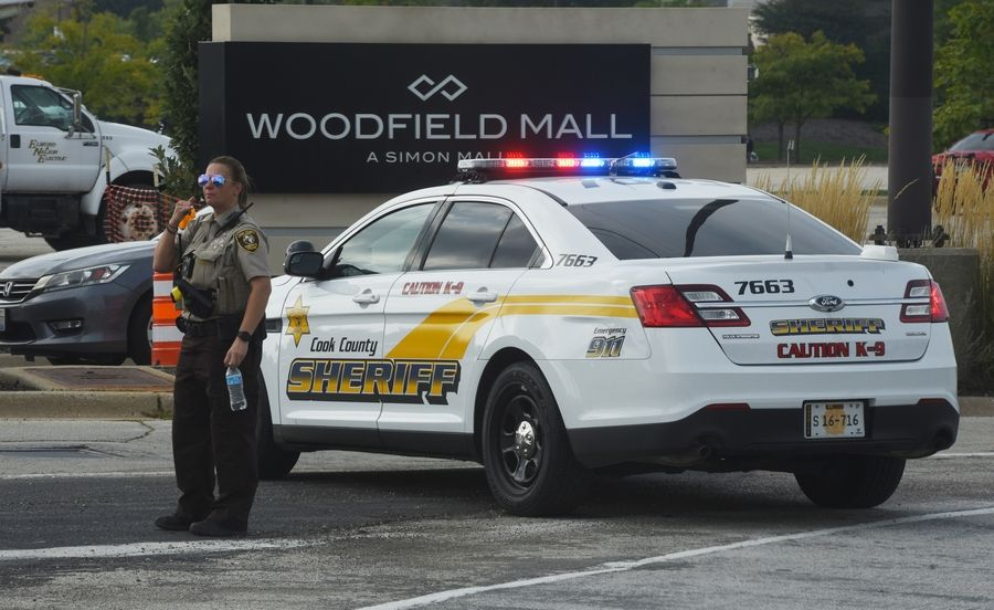 Cook County police officers tend to the scene at Woodfield Mall in Schaumburg on Friday. An SUV was driven through the front of Sears and into the mall.