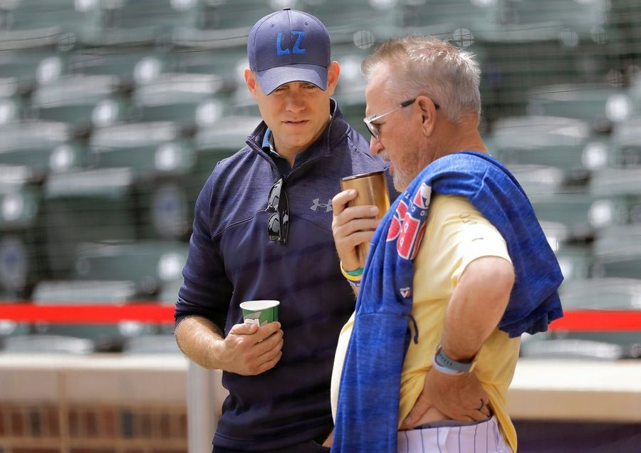 Chicago Cubs manager Joe Maddon, right, talks with President, Baseball Operations, Theo Epstein, while pitcher Yu Darvish's pitches a simulated game before a baseball game between the Cubs and the Los Angeles Dodgers Wednesday, June 20, 2018, in Chicago.
