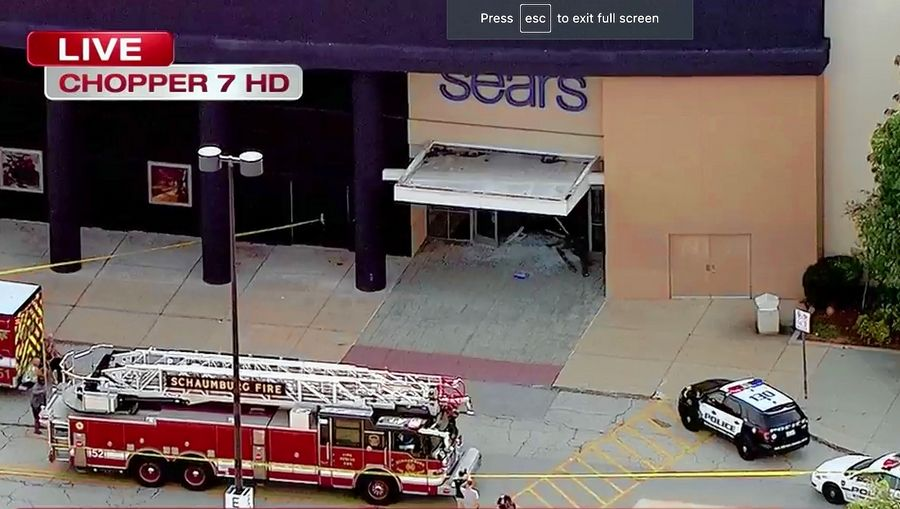An SUV crashed through the entrance of Sears Friday afternoon at Woodfield Mall, then was driven inside the mall.