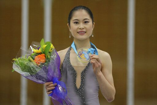 First-place finisher Satoko Miyahara, of Japan, celebrates on the podium following the women's free skate at the U.S. International Figure Skating Classic on Saturday, Sept. 21, 2019, in Salt Lake City.