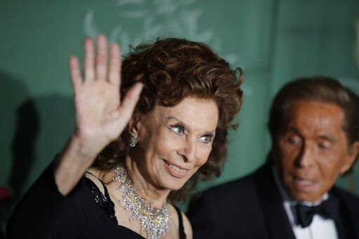 Actress Sophia Loren, left, and designer Valentino Garavani pose for photographers upon arrival at the Green Carpet Fashion Awards in Milan, Italy, Sunday, Sept. 22, 2019.