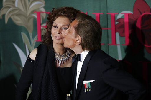 Designer Valentino Garavani, right, kisses actress Sophia Loren upon arrival at the Green Carpet Fashion Awards in Milan, Italy, Sunday, Sept. 22, 2019.