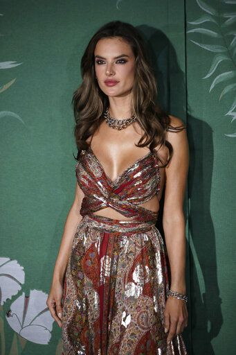 Model Alessandra Ambrosio poses for photographers upon arrival at the Green Carpet Fashion Awards in Milan, Italy, Sunday, Sept. 22, 2019.