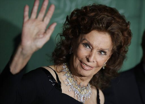 Actress Sophia Loren poses for photographers upon arrival at the Green Carpet Fashion Awards in Milan, Italy, Sunday, Sept. 22, 2019.