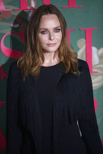 Designer Stella McCartney poses for photographers upon arrival at the Green Carpet Fashion Awards in Milan, Italy, Sunday, Sept. 22, 2019.