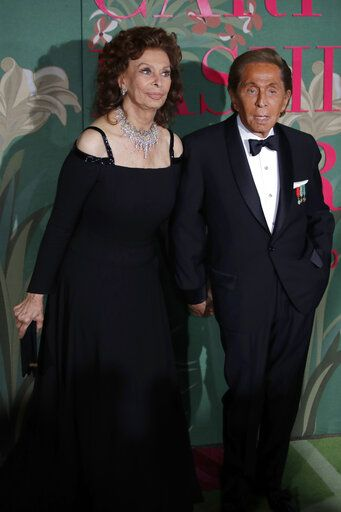 Designer Valentino Garavani, right, and actress Sophia Loren pose for photographers upon arrival at the Green Carpet Fashion Awards in Milan, Italy, Sunday, Sept. 22, 2019.