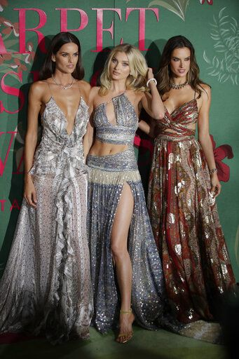Models Izabel Goulart, from left, Elsa Hosk and Alessandra Ambrosio pose for photographers upon arrival at the Green Carpet Fashion Awards in Milan, Italy, Sunday, Sept. 22, 2019.