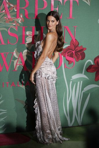 Model Izabel Goulart poses for photographers upon arrival at the Green Carpet Fashion Awards in Milan, Italy, Sunday, Sept. 22, 2019.