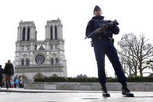 - FILE - In this March 27, 2016 file photo, a French police officer stands guards as worshipers arrive for the Easter mass at Notre Dame Cathedral, in Paris. Before it was ravaged by fire, Notre Dame Cathedral was the target of a bungled terrorist plot by two French women who pledged allegiance to the Islamic State group. They're going on trial Monday Sept.23 2019 in a special Paris court, for attempting to explode a vehicle laden with fuel-doused gas canisters in the shadow of the medieval monument in 2016. (AP Photo/Francois Mori, File)