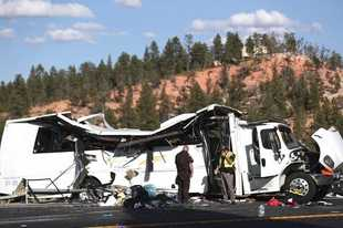 Authorities work the scene where at least four people were killed in a tour bus crash near Bryce Canyon National Park, Friday, Sept. 20, 2019, in Utah. (Spenser Heaps/The Deseret News via AP)