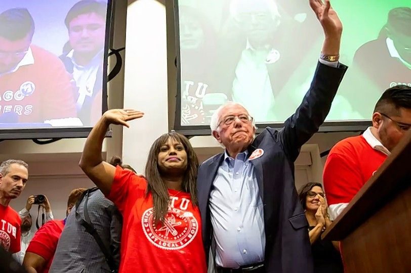 Democratic presidential candidate Bernie Sanders, shown with Chicago Teachers Union Vice President Stacy Davis Gates, spoke at a rally Tuesday night at union headquarters.