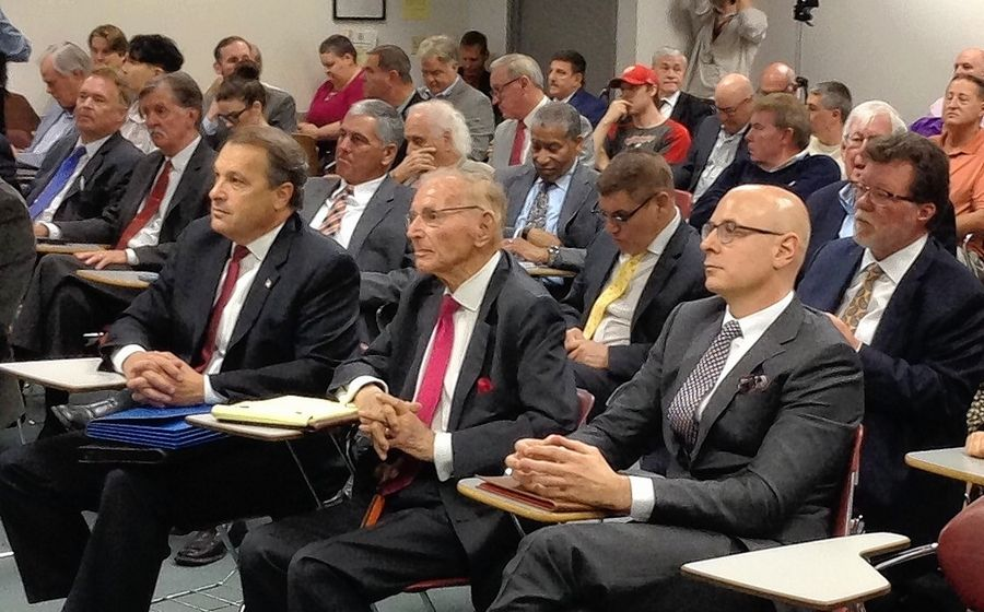 Arlington International Racecourse President Tony Petrillo, from left, Chairman Emeritus Richard Duchossois, and Churchill Downs Inc. Senior Vice President and General Counsel Brad Blackwell, sit front row at the Illinois Racing Board meeting Tuesday where racing dates were awarded for the 2020 season.