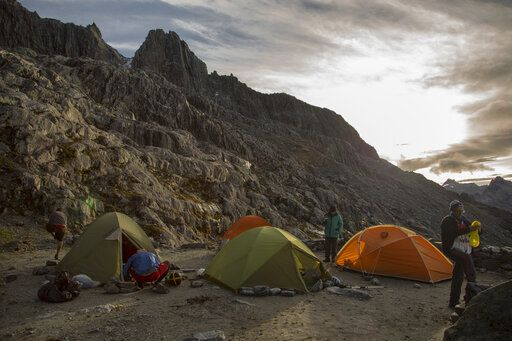 In this May 26, 2019 photo, scientists gather at their camp in the early morning before starting a four-day mission to the Humboldt glacier, in Merida, Venezuela. Temperatures are warming faster at the Earth's higher elevations than in lowlands, and scientists predict that the glacier _ an ice sheet in the Andes Mountains _ could be gone within two decades.