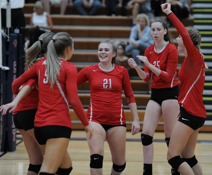 Palatine's Allison Drake and her teammates celebrate their win over Conant in a girls volleyball matchup at Conant on Thursday.