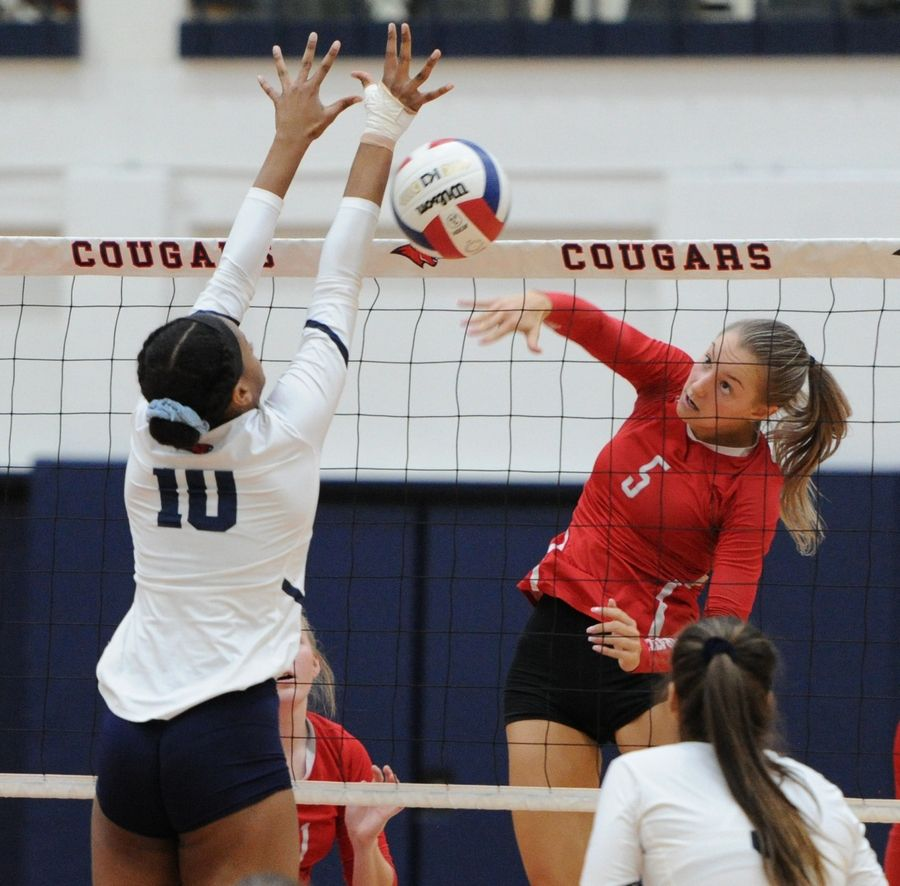 Conant's Jessica Sharp is unable to defend against Palatine's Karina Szafraniec's slam at the net as Palatine wins both games of the girls volleyball matchup at Conant on Thursday.