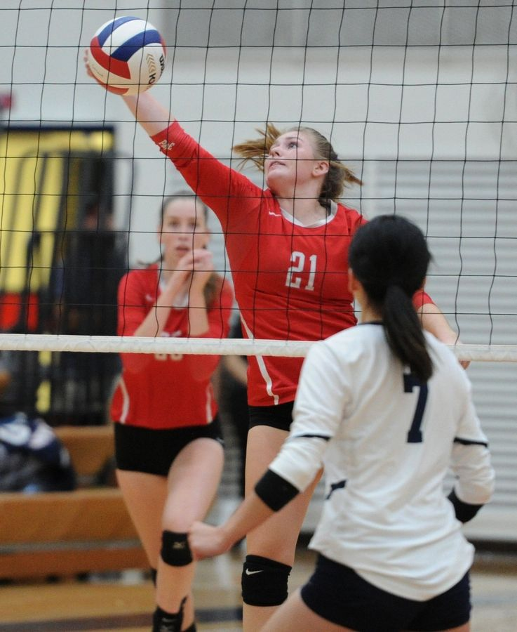 Palatine's Allison Drake hits a return at the net against Conant as Palatine wins the girls volleyball matchup at Conant on Thursday.
