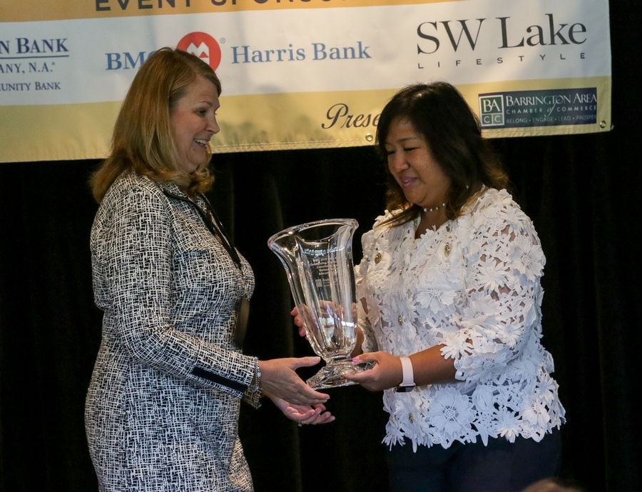 Melissa Buckley, founding board president of BStrong Together, left, accepts her Community Impact Award from Elaine Sambo-Reyther on Thursday at the Barrington Area Chamber of Commerce's Outstanding Women Leaders Awards Luncheon in North Barrington.