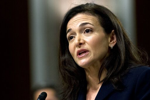 FILE- In this Sept. 5, 2018, file photo Facebook COO Sheryl Sandberg testifies before the Senate Intelligence Committee hearing on 'Foreign Influence Operations and Their Use of Social Media Platforms' on Capitol Hill in Washington. Facebook and civil rights group Color of Change are hosting a meeting Thursday, Sept. 26, 2019, in Atlanta to discuss problems around discrimination, racism and political deception on the site. Sandberg didn't directly respond to questions about the decision by Sherrilyn Ifill, president of the NAACP Legal Defense & Educational Fund, during a discussion by the two.