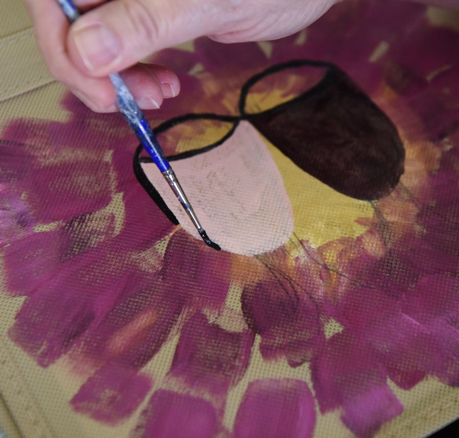 Julie Ventrella of Hanover Park paints a picture of wineglasses on canvas during the Corks and Crafts event at the Hanover Park Sports Complex Saturday.