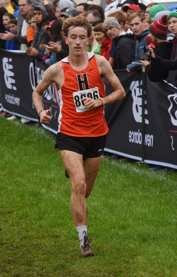 Hersey's Josh Methner wins the boys varsity race of the Palatine Cross Country Invitational at Deer Grove East Forest Preserve in Palatine Saturday.