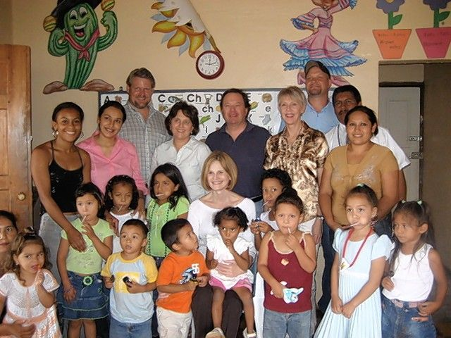 Students and teachers at Casa de Luz met with Mary Flake de Flores, the former first lady of Honduras, seated in second row. Fabiola, who started at Casa de Luz as a scared little girl and came out of her shell, is pictured on the far right in front. She is now a successful young adult.
