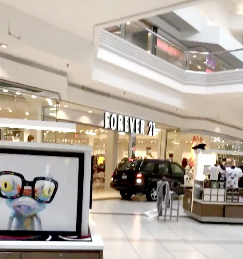 A frame grab from a video by Ronin Diedenhofen shows an SUV going through Woodfield Mall in Schaumburg on Sept. 20.