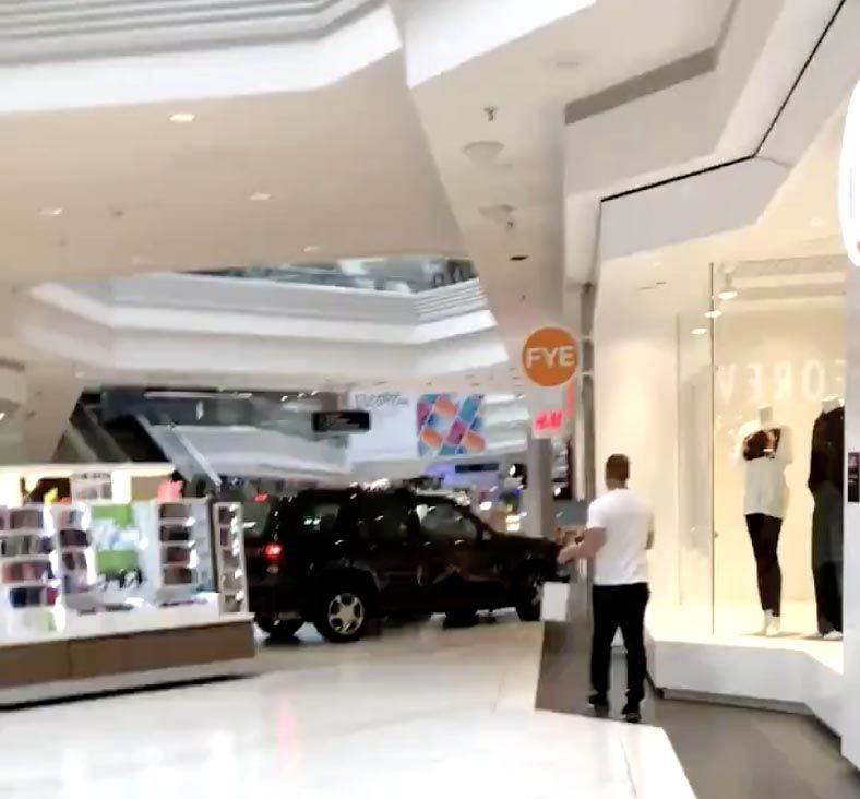 This frame grab from a video by Ronin Diedenhofen shows an SUV going through Woodfield Mall in Schaumburg on Sept. 20.