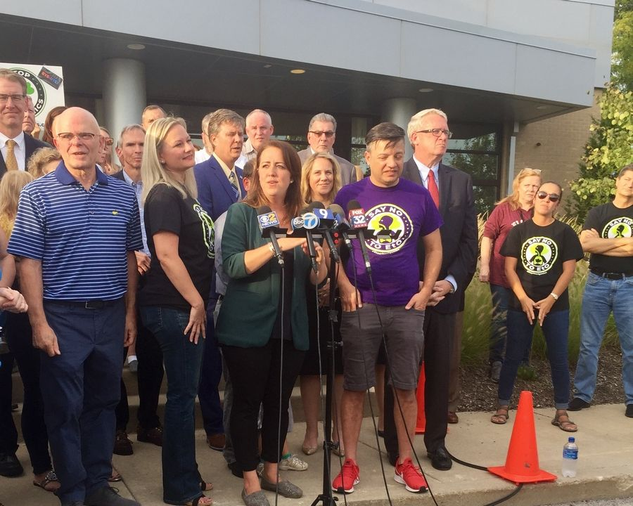 Willowbrook resident Lauren Kaeseberg talks about Sterigenics' decision to leave while other citizens and Republican House Leader Jim Durkin, far right, listen.
