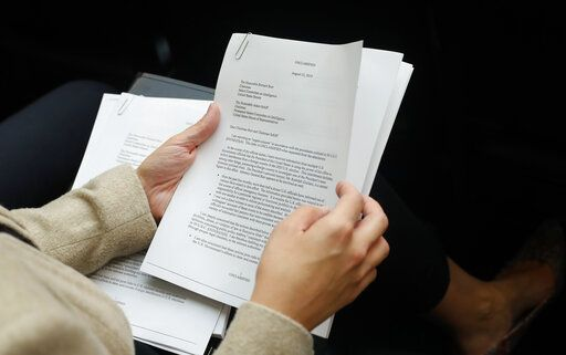 A member of the audience holds a copy of the Whistle-Blower Complaint letter sent to Senate and House Intelligence Committees during testimony by Acting Director of National Intelligence Joseph Maguire before the House Intelligence Committee on Capitol Hill in Washington, Thursday, Sept. 26, 2019.