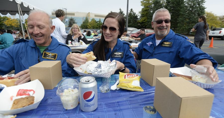 Flight for Life helicopter crew, Jerry Notowitz, pilot, from Johnsburg, Flight Nurse Kira Dimitrijevich of Grayslake and Scott Anderson, flight paramedic from McHenry, eat lunch as part of Advocate Condell Medical Center's 10th anniversary celebration of its Level 1 trauma center in Libertyville on Tuesday.