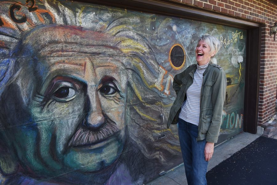 Kate Tully of Prospect Heights creates a new mural on her garage door ever year. This year the garage door features a mural of Albert Einstein.