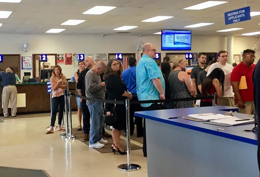A computer malfunction causes a long line outside the Lombard DMV Tuesday morning.