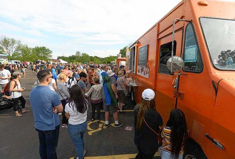 The first Elgin Food Truck Fest organized by Brew Avenue Events will take place Friday in Elgin. Pictured here is the Cantigny Food Truck Festival in June in Wheaton, organized by the same company.