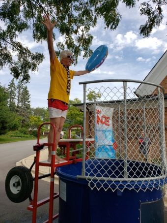 Jim Hall, treasurer and longtime member of Faith Lutheran Church in Glen Ellyn, braves the dunk tank.