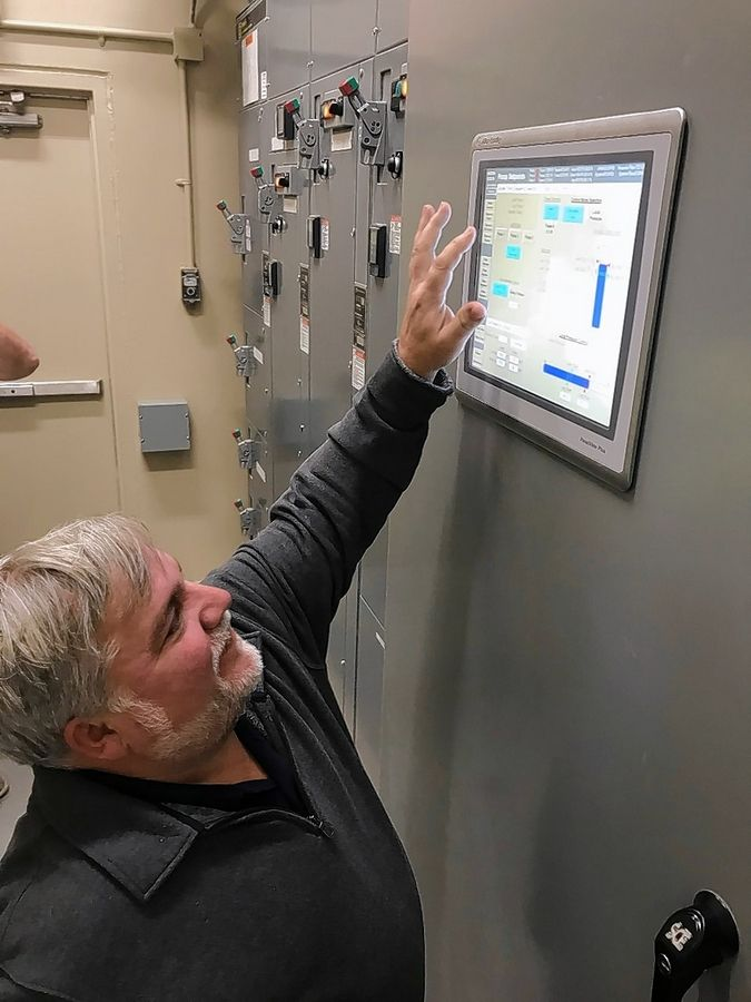 Wauconda Mayor Lincoln Knight pushes the button Thursday to activate the village's new Lake Michigan water system. More than 13 years and $48 million in the making, the system will be delivering Lake Michigan water to all Wauconda homes and businesses within two or three days.