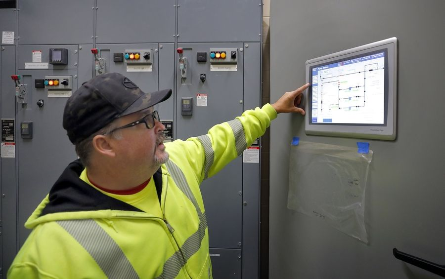 Wauconda water operator Mark Gedde shows the computerized control center at the new Lake Michigan water system booster station on Gilmer Road.