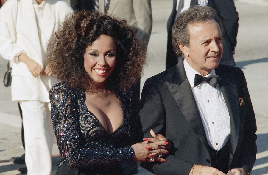 FILE -- This Sept. 21, 1986 file photo shows singers Vic Damone, right, and Diahann Carroll at the Emmy awards in Los Angeles. Carroll died, Friday, Oct. 4, 2019, at her home in Los Angeles after a long bout with cancer. She was 84.