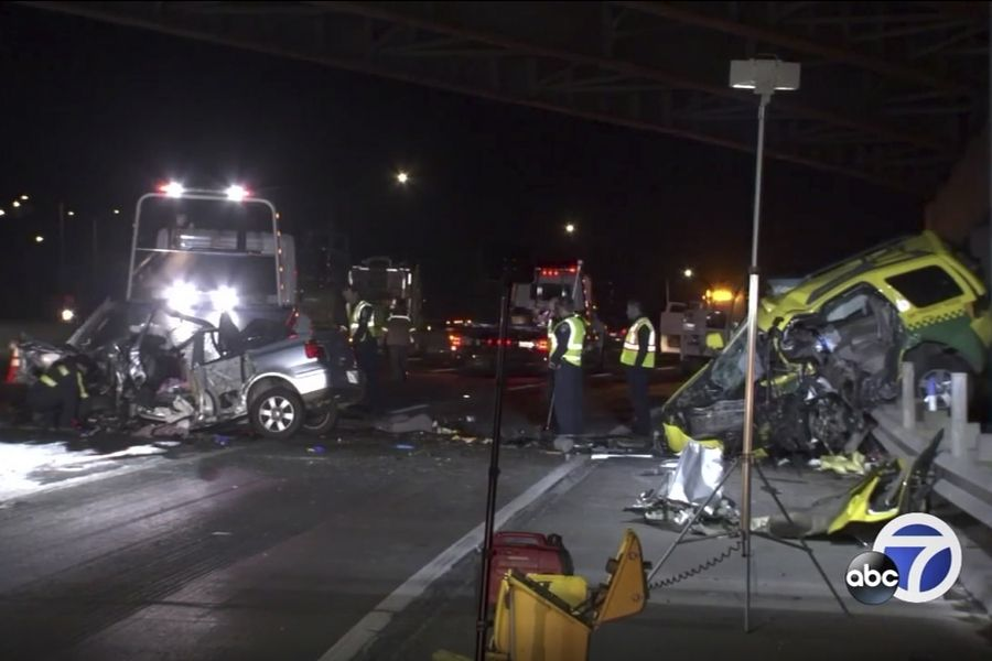 This photo taken from video provided by KGO-TV shows the scene of a car crash that authorities say killed four people on a highway in San Francisco, including Judson Bergman and his wife, Mary Miller-Bergman of the Barrington area. The California Highway Patrol says the collision happened Thursday about 12:30 a.m., just minutes after people started calling authorities to report a Volkswagen sedan driving south in the northbound lanes of Highway 101.