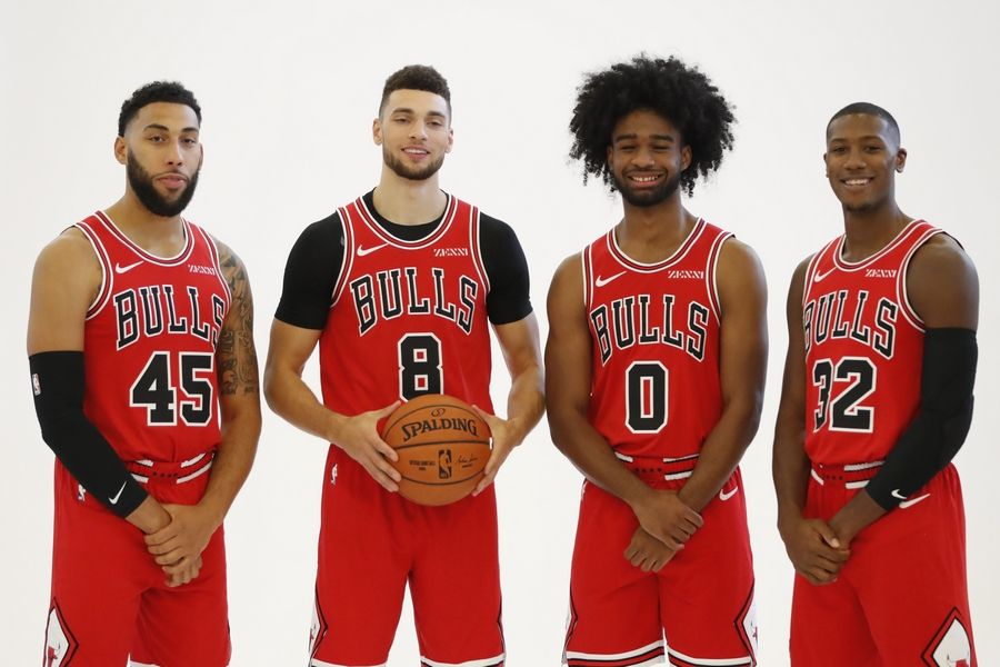 The Chicago Bulls players, from left to right, Denzel Valentine (45) Zach LaVine (8) Coby White (0) and Kris Dunn (32) pose for a photo during the NBA basketball team's media day Monday, Sept. 30, 2019, in Chicago.