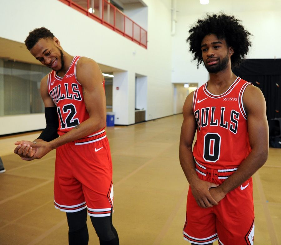 Mark Welsh/mwelsh@dailyherald.comChicago Bulls' Coby White (right) and teammate Daniel Gafford share a laugh at the Chicago Bulls media day in Chicago.