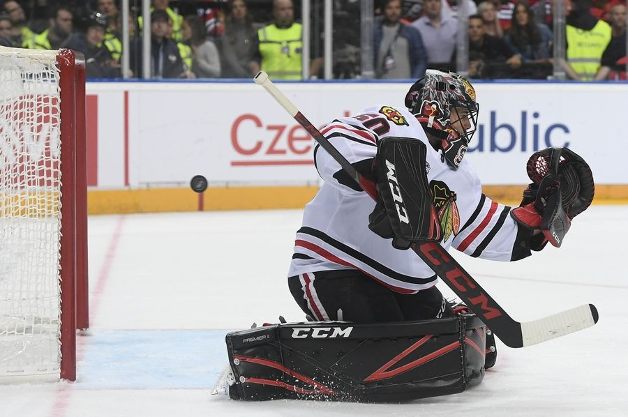 Chicago Blackhawks goaltender Corey Crawford is unable to stop a shot for a goal by Philadelphia Flyers' Travis Konecny during an NHL Global Series ice hockey game in Prague, Czech Republic, Friday, Oct. 4, 2019. (Ondrej Deml/CTK via AP)