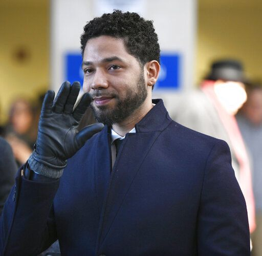 FILE - In this March 26, 2019 file photo, actor Jussie Smollett smiles and waves to supporters before leaving Cook County Court after his charges were dropped, in Chicago. A Chicago judge is expected to decide whether to let a former U.S. attorney stay on as special prosecutor examining the dismissal of charges against actor Smollett. The hearing Friday, Oct. 4, 2019, comes after Dan Webb revealed he co-hosted a fundraiser for Kim Foxx during her 2016 run for Chicago's top prosecutor job. Her office in March abruptly dropped charges accusing Smollett of staging a racist, homophobic attack on himself.